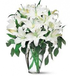 White Lilies  In A Glass Vase