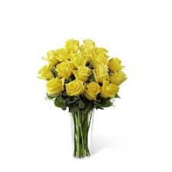 Glass Vase Arrangement Of Yellow Roses