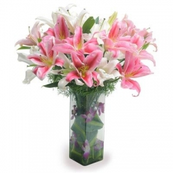 White And Pink Lilies In A Glass Vase