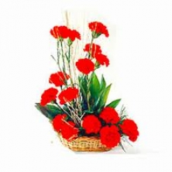 Basket Arrangement Of Red Carnations